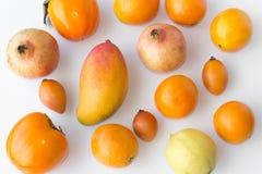 Many fresh orange fruits on white background - Royalty Free Stock Photography