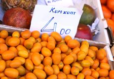 Many fresh orange kumkuat a tropical fruit for sale. At greengrocer store Stock Photos