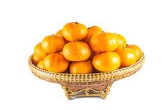 Many fresh oranges in basket Stock Photos