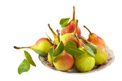 Many fresh pears on the plate Royalty Free Stock Photography