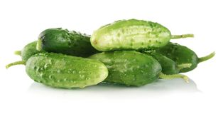 Many fresh raw cucumbers isolated on white Royalty Free Stock Photography