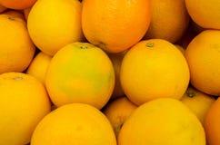 Many fresh raw orange. Many children in the orange truck Stock Photos