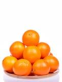 Many fresh raw orange isolated on white Stock Photos