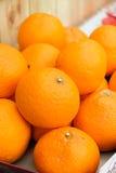 Many fresh raw orange. In the market Stock Image