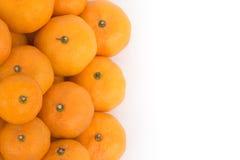 Many fresh raw orange on white background. Many fresh raw orange and isolation background Royalty Free Stock Photos