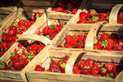Many fresh red strawberries in a wooden basket Stock Photo