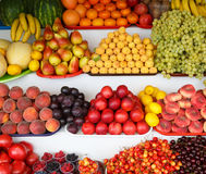 Many fresh, ripe and useful fruits lie on the counter Stock Photography