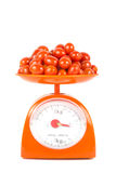 Many fresh small tomato. Lying on weight scale Stock Photography