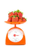Many fresh small tomato. Lying on weight scale Royalty Free Stock Photos