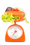 Many fresh vegetables. Lying on weight scale Stock Photos
