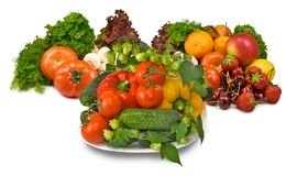 Many fresh vegetables and berries on a plate Stock Photography