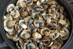 Many fried mushrooms in a pan closeup Royalty Free Stock Images
