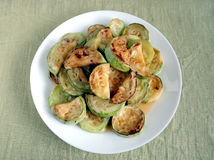 Fried zucchini slices on white plate Stock Images