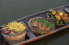 Many fruit in the basket in the boat at traditional floating market Royalty Free Stock Images