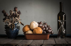 Many fruits and glass on the table. Royalty Free Stock Photos
