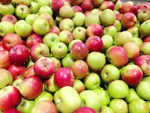 Many fruits green, red apples at supermarket. Close-up stock photography