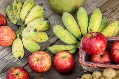 Many fruits on the wooden floor Royalty Free Stock Image
