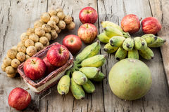 Many fruits on the wooden floor Stock Photos