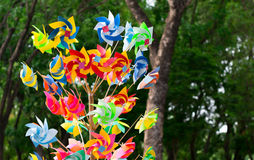 Many fun colorful pinwheels spinning in the wind at a carnival p Stock Photography