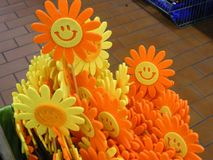 Many funny yellow and orange smiles in form of sun for spring or summer garden. Many funny yellow and orange smiles in form of sun for spring garden Stock Image