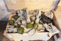 Many gas masks in a chest Stock Photos