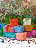 Many gift boxes on a fir branches background closeup Royalty Free Stock Image