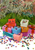 Many gift boxes on a fir branches background Stock Image