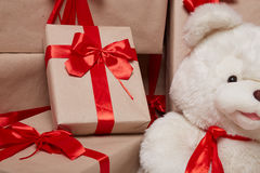 Many gifts, boxes with gifts covered with red satin and silk ribbon with big bow, merry Christmas and a happy new year, surprise, Stock Image