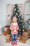 Many gifts and little girl Royalty Free Stock Photos