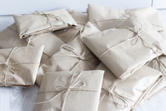 Many gifts. A lot of presents in kraft packaging Stock Images
