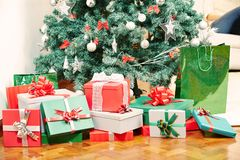 Many gifts under christmas tree. Many gifts laying under christmas tree at christmas eve Royalty Free Stock Photography