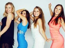 Many girlfriends hugging celebration on white background, smilin Stock Photos