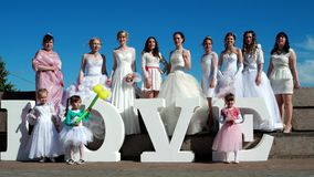 Many girls in wedding dresses, Many girls in wedding dresses, show class, a gesture of approval at arm's length