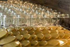 Many glass jar empty glasses row for jam honey with lid caps abstract background bokeh Stock Image