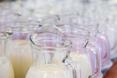 Many glass jugs with milk and yogurt Royalty Free Stock Photography