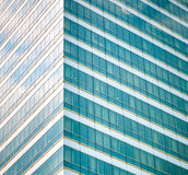 Many glass windows from the high-rise building. With cloudy sky reflection Stock Photography
