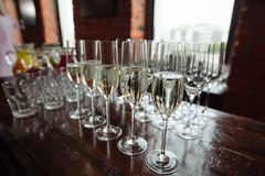 Many glasses of champagne over blur glasses background Royalty Free Stock Photos