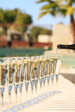 Many glasses of champagne or prosecco near resort pool in a luxu Royalty Free Stock Image