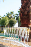 Many glasses of champagne or prosecco near resort pool in a luxu Royalty Free Stock Photography