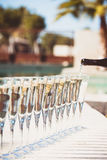 Many glasses of champagne or prosecco near resort pool in a luxu Stock Images