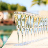 Many glasses of champagne or prosecco near resort pool in a luxury hotel. Pool party. royalty free stock photos