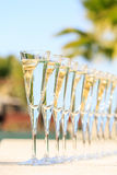 Many glasses of champagne or prosecco near resort pool in a luxu Stock Image
