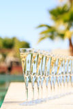 Many glasses of champagne or prosecco near resort pool in a luxury hotel. Pool party. Vertical royalty free stock photos