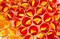 Many glasses of fresh alcoholic welcome drinks with pieces of oranges. A lot of glasses in rows side by side royalty free stock image