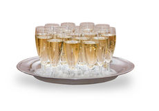 Many glasses full of champagne on the tray Stock Photo