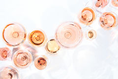 Many glasses of rose wine at wine tasting. Concept of rose wine. And variety. White background. Top view, flat lay design. Horizontal royalty free stock photo