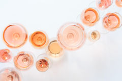 Many glasses of rose wine at wine tasting. Concept of rose wine stock photos