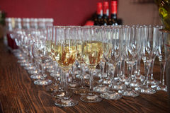 Many glasses with white wine on buffet table. Soft focus, selective focus Stock Photo