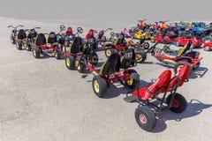 Many go-karts parked on asphalt terrain. Many go-karts for children standing on asphalt terrain Stock Photography