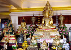 Many gold-colored Buddha statue in Buddhist temple Royalty Free Stock Image